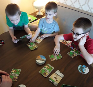 How games can enrich homeschooling. Dinosaur Challenge by SimplyFun.