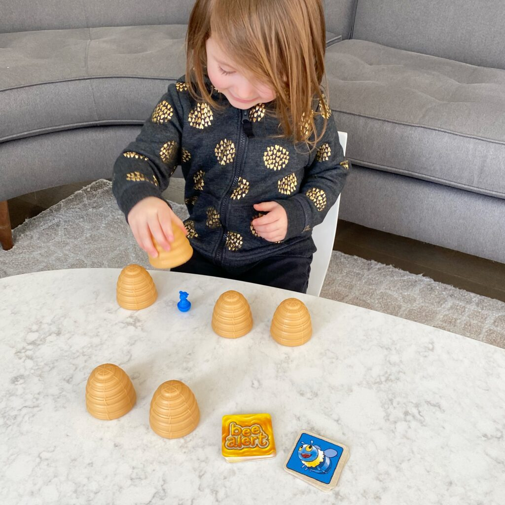 girl playing Bee Alert game