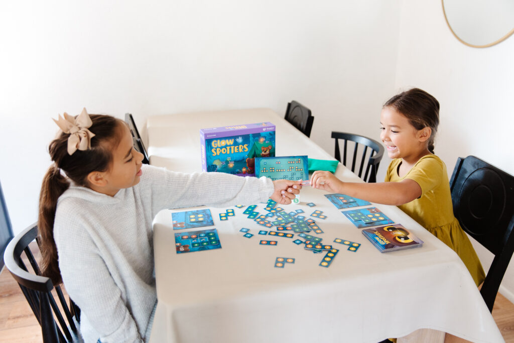 Girls playing Glow Spotters game by SimplyFun