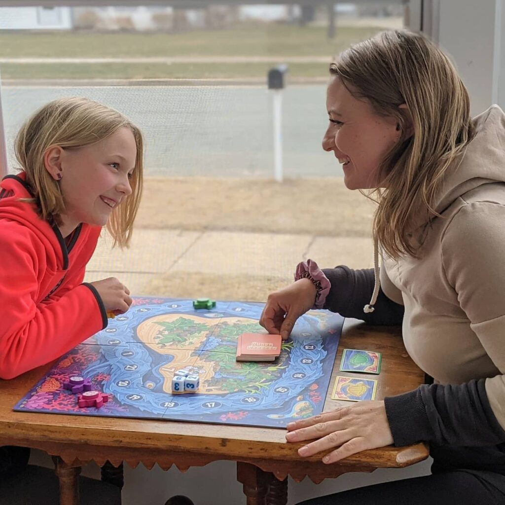 Mom and daughter play Shore Seekers by SimplyFun